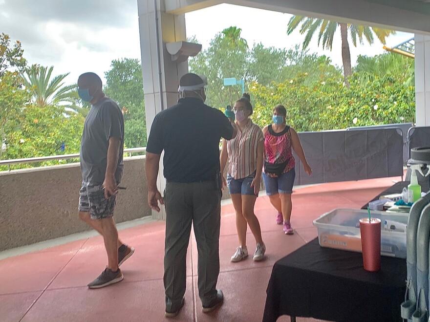 Staff taking temperature checks at Universal Orlando Resort.