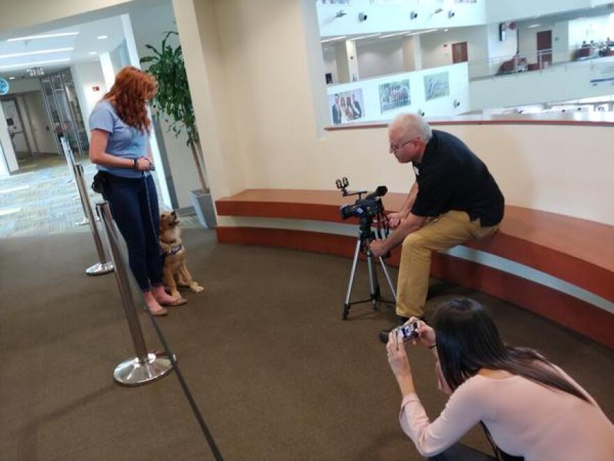 Finley is not sure she's ready for her close-up, as WUSF video producer Andy Lalino and radio intern Eillin Delapaz try to get a shot.