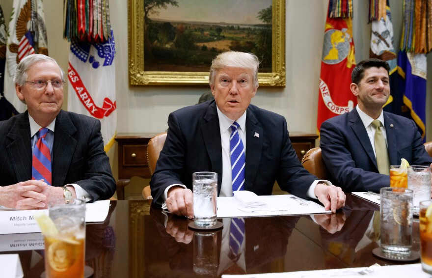 President Trump with Senate GOP leader Mitch McConnell (left) and House Speaker Paul Ryan (right) at the White House. All three will have to sell the new health care plan to skeptical factions.