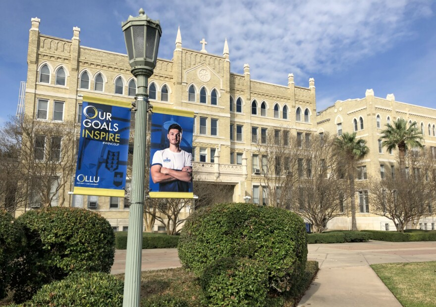 A pathway, building and banner on the Our Lady of the Lake University campus on San Antonio's West Side.