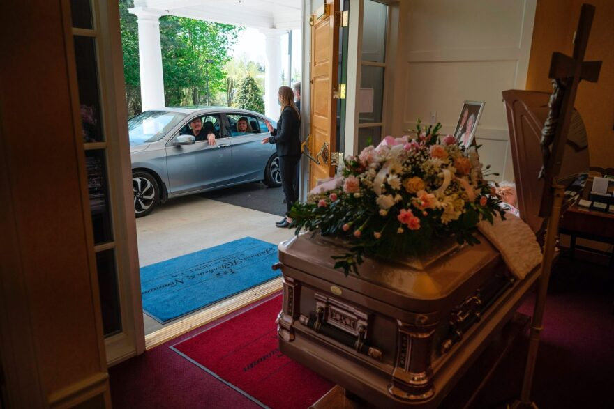 An attendee drives past during a viewing for Mrs. Barbara Lipscomb at the Fellows, Helfenbein & Newnam Funeral Home in Centreville, Maryland.