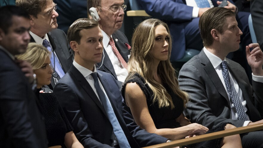 Jared Kushner and his wife, Ivanka Trump, reportedly set up a private email account as their family was coming into power in Washington, D.C. They're seen here last week at left, sitting with Lara Trump and Eric Trump.