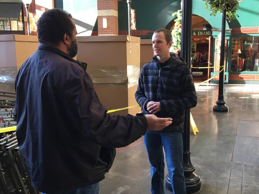 Newly hired Spokane County Sheriff's Deputy Russell Aldrich chats with strangers in a shopping mall. The exercise is meant to help rookies build up the subtle people skills that older police trainers claim are lacking among many millennial recruits.
