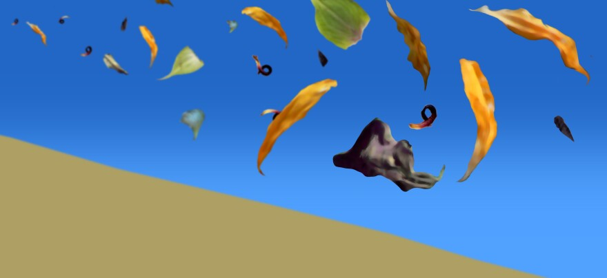 Leaves blowing over a dune.