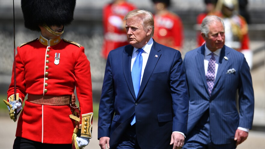 President Trump (center) inspects an honor guard with Prince Charles on Monday after arriving at Buckingham Palace in London.
