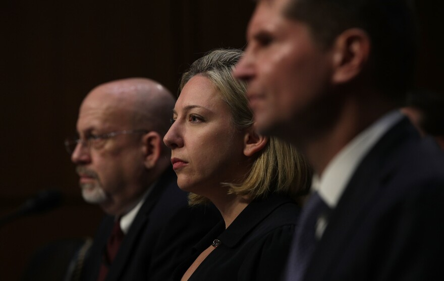 (From left) Sam Liles, acting director of Homeland Security's Office of Intelligence and Analysis Cyber Division, Jeanette Mafra, acting director of DHS' national protection and programs directorate, and Bill Priestap, assistant director of the FBI's Counterintelligence Division, testify during a hearing before the Senate Intelligence Committee on Wednesday.