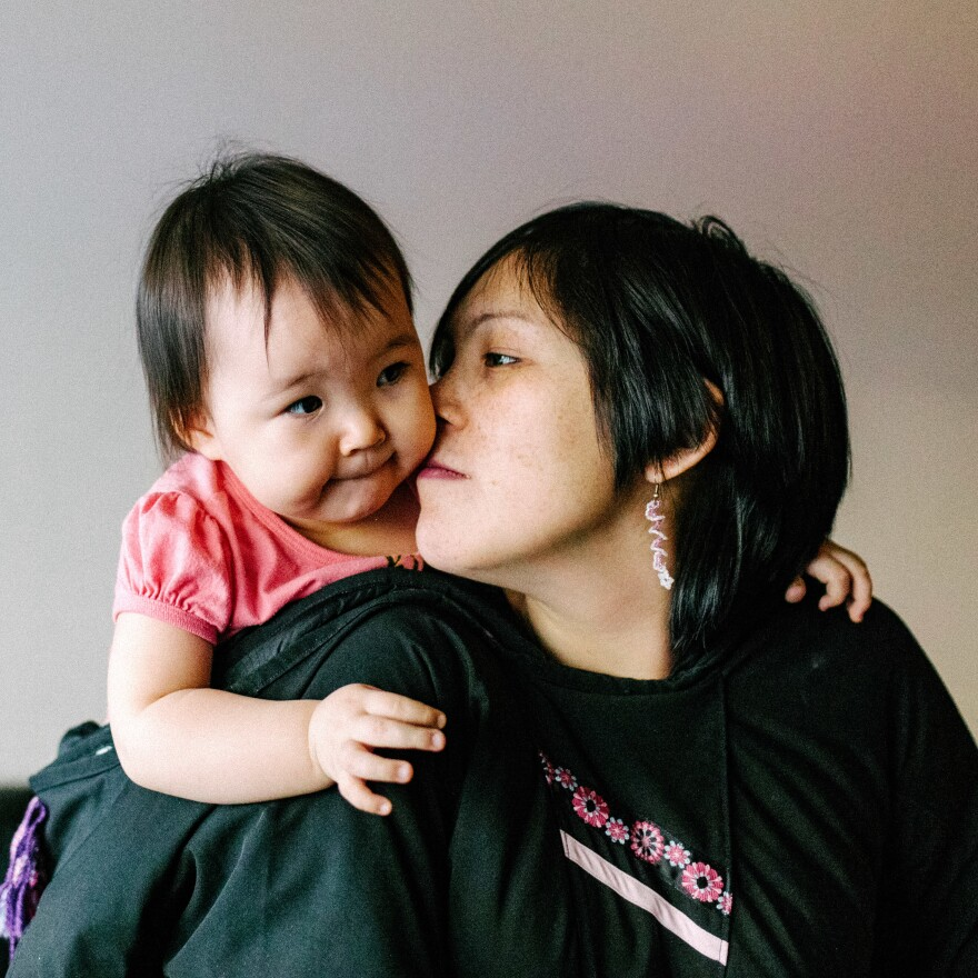 Inuit parenting is gentle and tender. They even have a special kiss for kids called <em>kunik</em>. (Above) Maata Jaw gives her daughter the nose-to-cheek Inuit sniff.