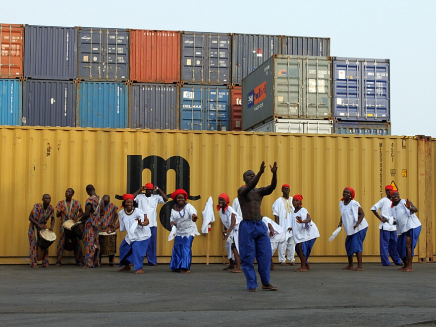A cultural troupe dances for tourists arriving on the National Geographic Explorer in Monrovia, Liberia, this week.