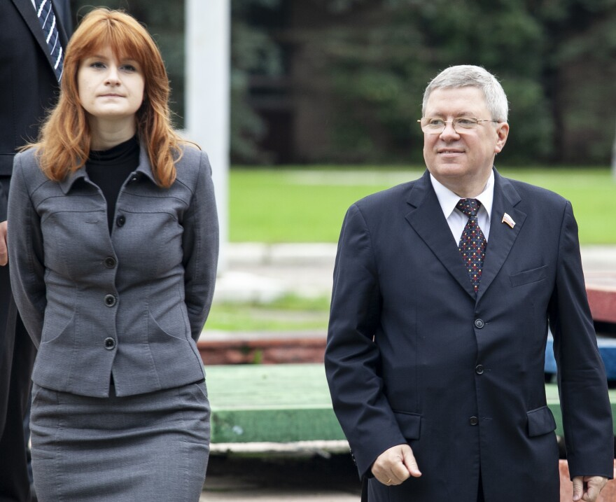 Maria Butina walks with Alexander Torshin, then a member of the Russian upper house of Parliament, in Moscow in 2012. The Senate Finance Committee is now investigating a think tank linked to both of them.