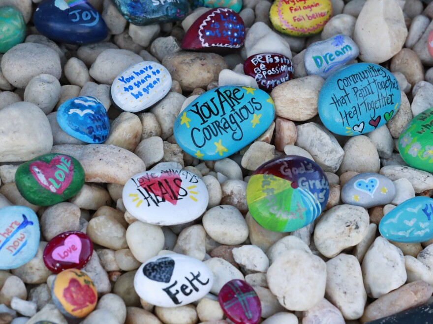Painted stones at a memorial outside Marjory Stoneman Douglas High School.