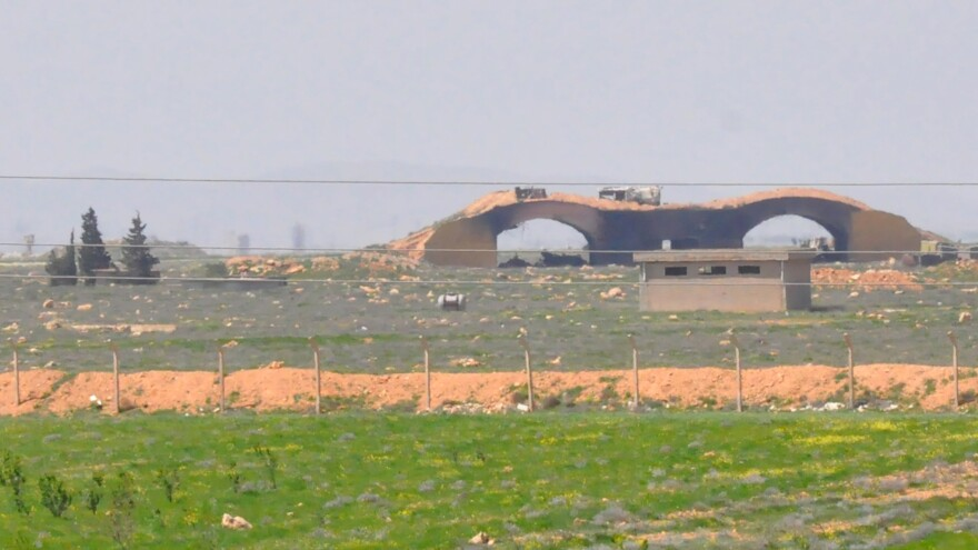 A picture taken Friday shows the damaged Shayrat airfield at the Syrian military base targeted overnight by U.S. Tomahawk cruise missiles, southeast of the central Syrian city of Homs.