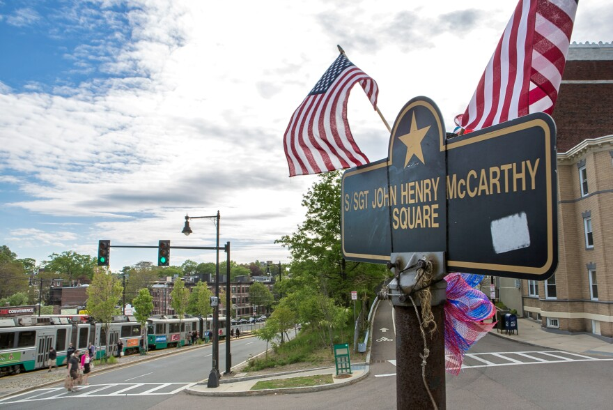 A memorial honors Staff Sgt. John Henry McCarthy on the corner of Commonwealth Avenue and Colborne Road in Boston.