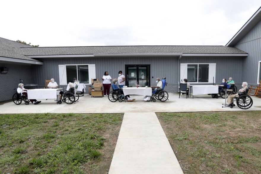 nursing home residents outside in wheelchairs
