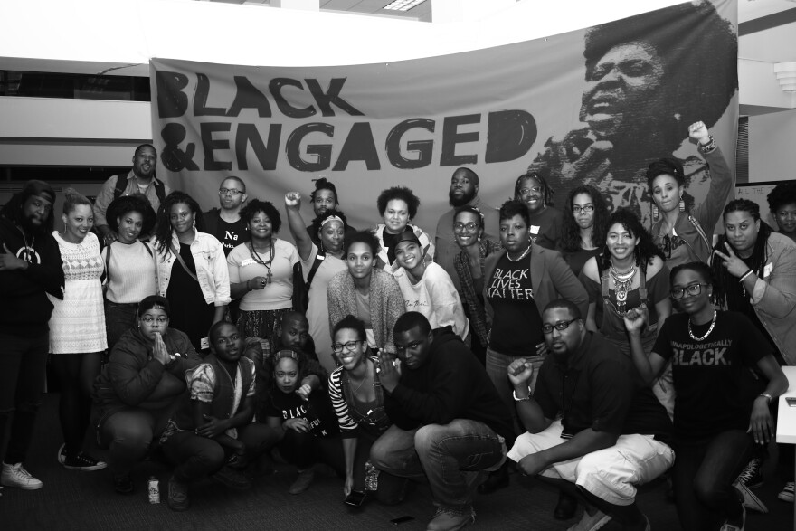 Participants gather at the end of the weekend under a banner used in all the previous trainings held in Atlanta, Los Angeles, and Philadelphia. St. Louis was the final Black & Engaged training this year.