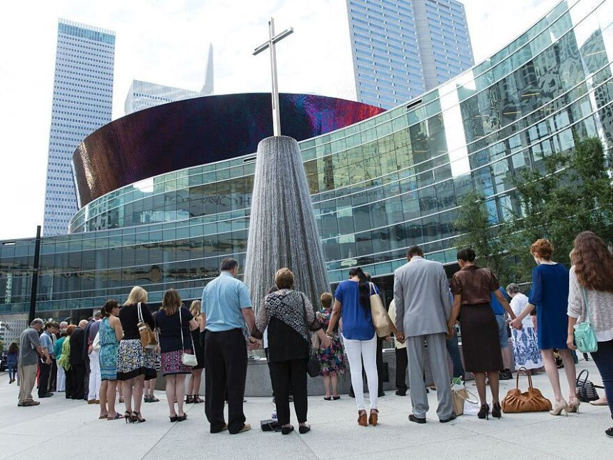 Parishioners of First Baptist Church in Dallas, Texas, gather on July 10, 2016, to pray for the five police officers killed when a man used a high-power rifle in a sniper attack at a protest in Dallas late July 7.