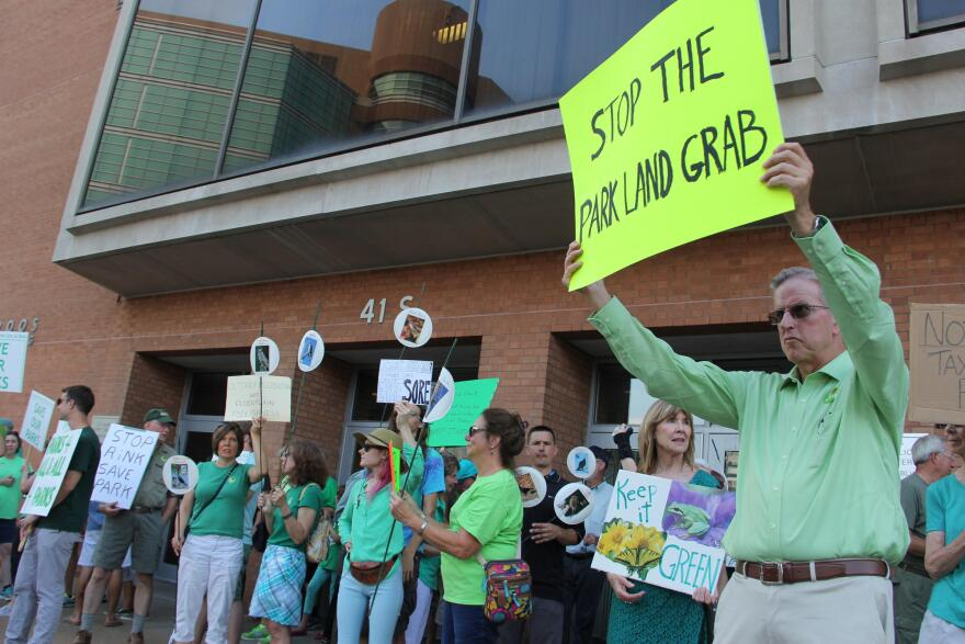 Environmental groups and residents stood outside of the St. Louis County Administration Building in Clayton to protest a proposed project to build a four ice rinks in Creve Coeur Lake Memorial Park.