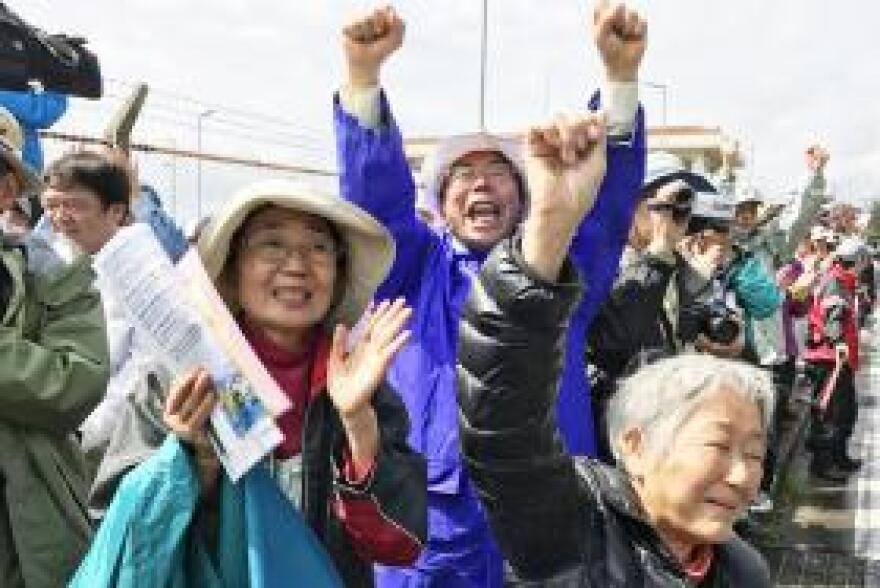Etsuko Urashima (left) and other protestors rally against the expansion of a U.S. Marine Corps base in the northern part of Okinawa island. Urashima is concerned about the construction of runways in the coastal waters.