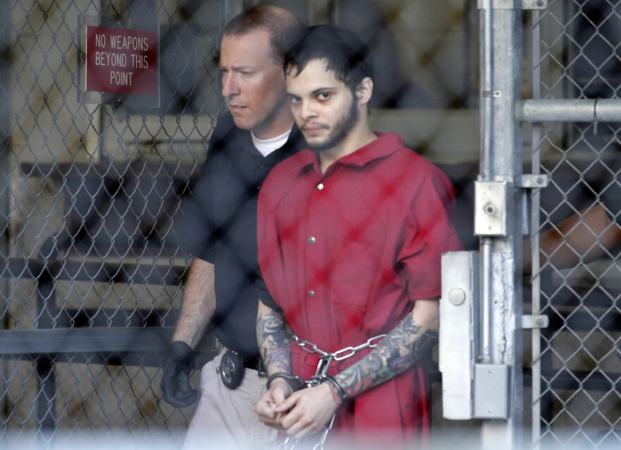 Esteban Santiago, seen leaving the Broward County jail for a hearing in January 2017, has been sentenced to life in prison for a shooting rampage at the Fort Lauderdale-Hollywood International Airport.