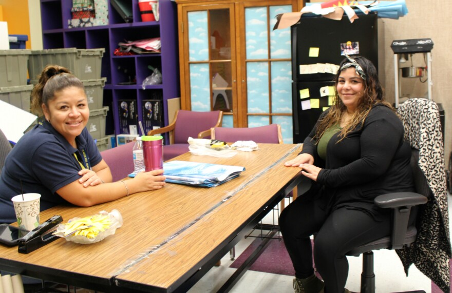 Mercedes Galmiche, left, and Janet Espino are parent volunteers at SAISD's Beacon Hill Academy.