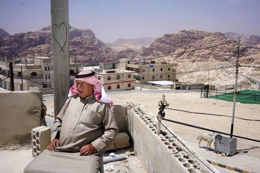 Bedouin village elder Ali Mutlaq Salem sits on his roof in the village of Um Sayhoun, on the outskirts of Petra. Salem was born and raised in one of the caves in Petra.