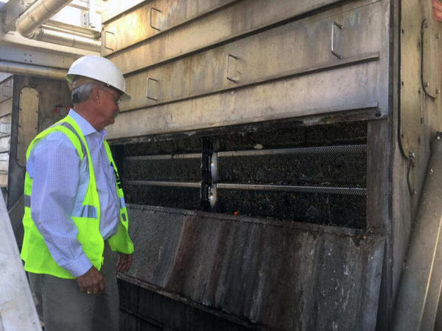 Bill Cyrus, manager of Technical Services with Trinity River Authority, looks at screens that filter out debris in wastewater, like wet wipes.