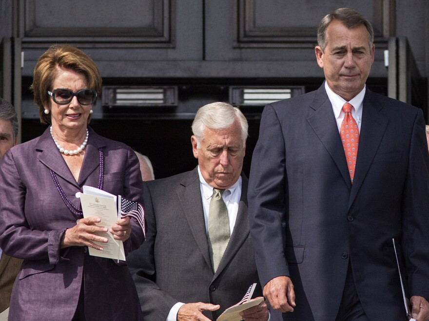 House Speaker John Boehner of Ohio (right) leads members of Congress as they step outside the Capitol on Wednesday to attend a ceremony in remembrance of the Sept. 11, 2001, terrorist attacks. With him are House Minority Leader Nancy Pelosi and House Minority Whip Steny Hoyer.