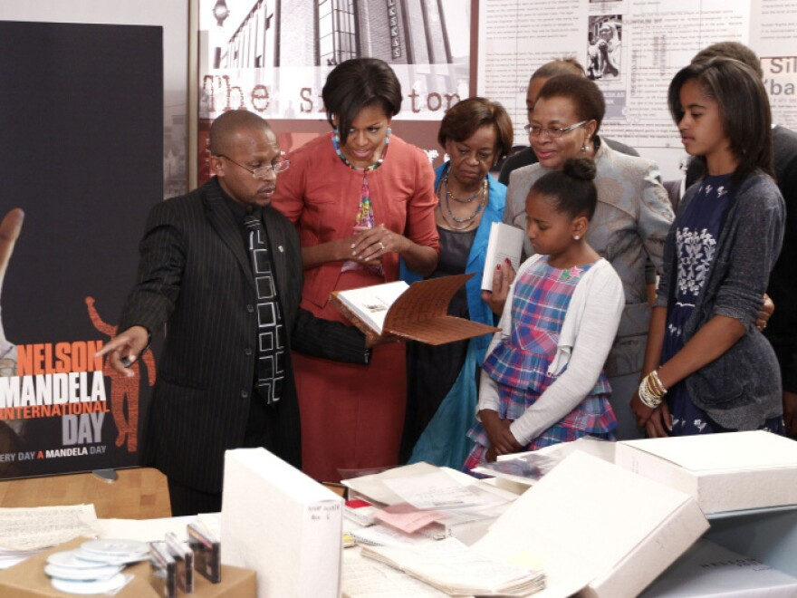 First lady Michelle Obama visits the Nelson Mandela Foundation in Johannesburg, South Africa on Tuesday. Pictured from left to right: Sello Hatang of the Nelson Mandela Foundation; Michelle Obama; mother Marian Robinson; Nelson Mandela's wife Graca Machel and Michelle Obama's daughters Sasha and Malia.