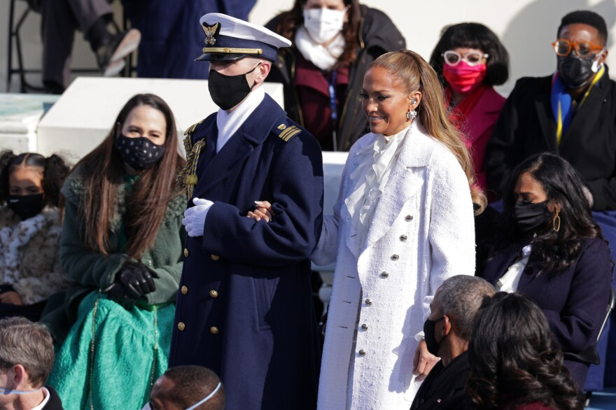 Jennifer Lopez is escorted to the inauguration of President-elect Joe Biden.