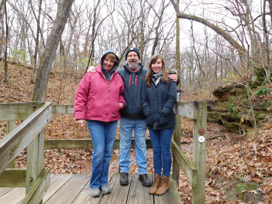 Larry Lenkart (center) with his wife Karen and daughter Maggie in November 2016.