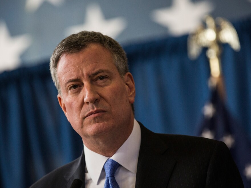 New York City Mayor Bill de Blasio said Sunday that the city will no longer use its previous threshold for closing schools.