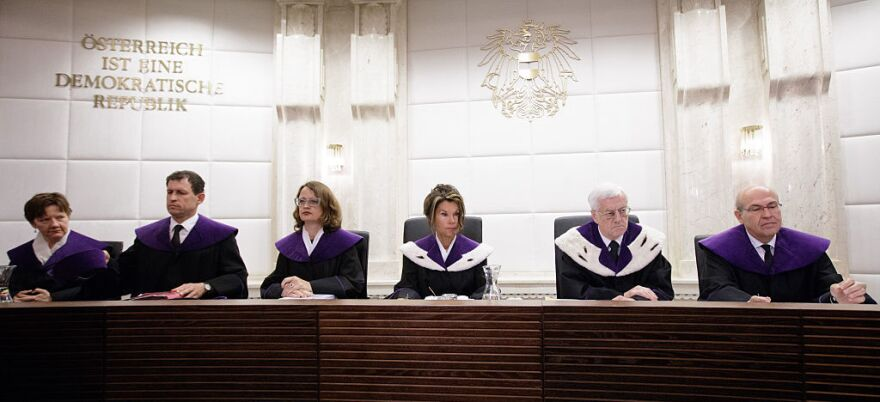 Members of Austria's Constitutional Court appear ahead of a public hearing earlier this month to consider annulling the result of the country's May runoff.