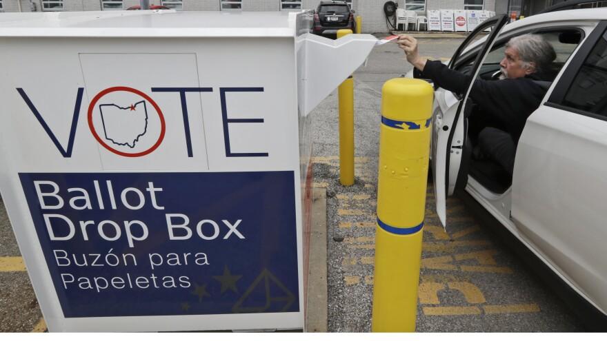 Jim O'Bryan drops off ballot in drop box at Cuyahoga County Board of Elections