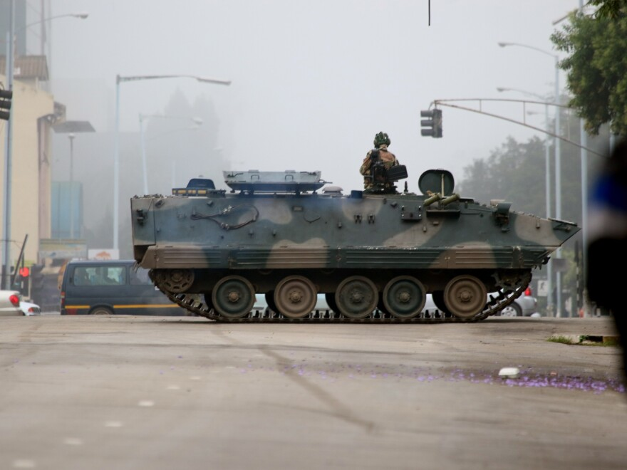 An armored personnel carrier seals off a main road to the presidential office in Harare, Zimbabwe, on Wednesday.