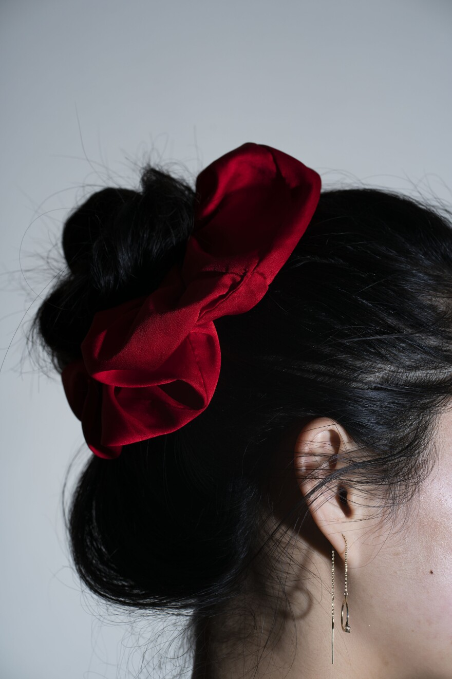 For being just a few inches of fabric around an elastic band, a scrunchie can elicit a surprising amount of emotions and memories.