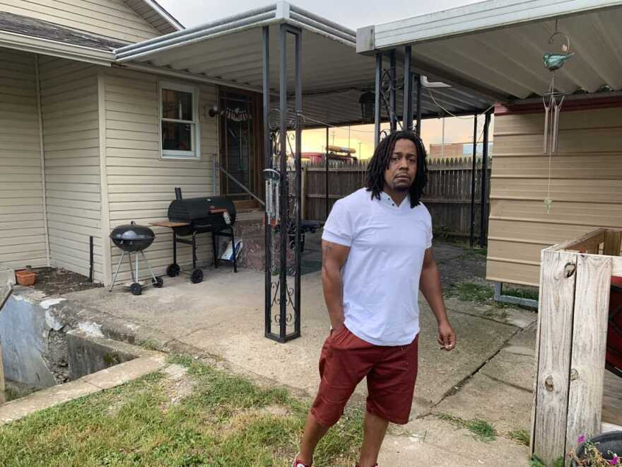 Dion Green in the backyard of his Dayton house, which has been repaired since May tornadoes badly damaged the property. Green's dad, Derrick Fudge, died in the mass shooting in the city's Oregon District last Sunday.