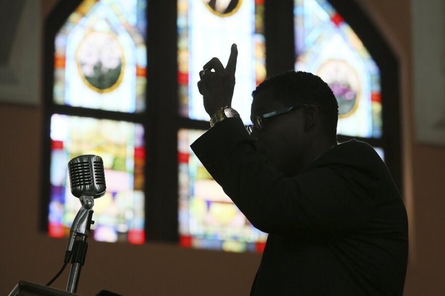 In this Aug. 28, 2013 file photo, Rev. Shanan Jones delivers a sermon at Ebenezer Baptist Church in Atlanta. According a study released on Dec. 16, 2019, by the Pew Research Center, the median length of U.S. sermons in April and May was 37 minutes.