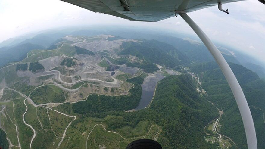 """Aerial view of mountaintop removal in West Virginia. The """"lake"""" in the center is a coal sludge waste impoundment."""