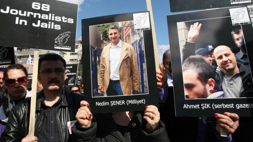 Hundreds of journalists protest the arrests of members of the media, including Ahmet Sik (poster on the right) and Nedim Sener (center) in Ankara, Turkey, in March 2011. Critics say the government is trying to stifle dissent by arresting journalists — for doing their job.