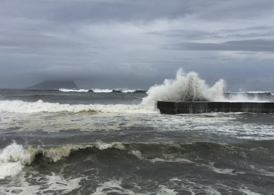 As fast-moving Typhoon Nepartak makes its way across the Philippines Sea, large waves crash against the breakwaters Thursday in Ilan on the eastern coast of Taiwan.