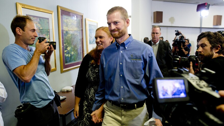 Ebola survivor Dr. Kent Brantly and his wife, Amber, leave a news conference after his release from Emory University Hospital on Aug. 21.