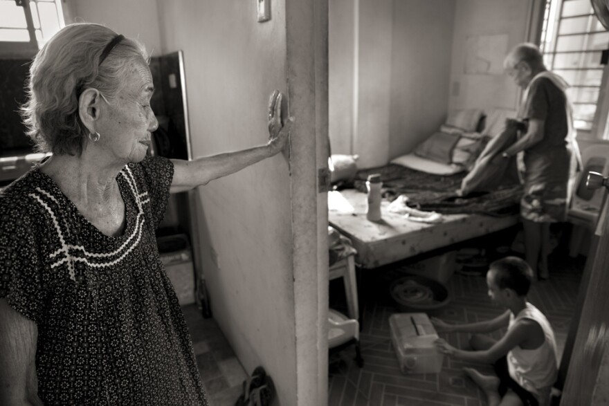 "Narcisa Claveria, watches husband, Anaceto, and their great-grandson as he wakes up from a nap at their home in Manila. At age 12, Narcisa was dragged from her home by Japanese soldiers and forced to serve as a sex slave in a garrison for 1 1/2 years. At a time when the experience was seen as a mark of shame, her husband encouraged her to share her story and told her: ""I am not repulsed by you."""