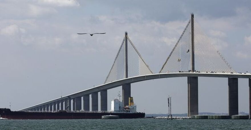 New construction of the Sunshine Skyway Bridge on a cloudy day.