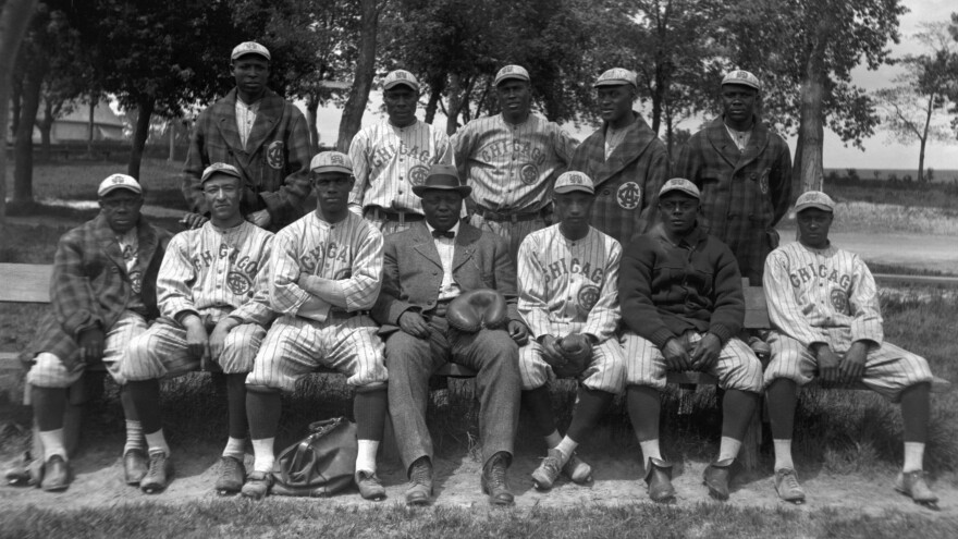 "Members of the Chicago American Giants pose for a team portrait in 1914 in Chicago. (L to R) (Front row) Billy ""Little Corporal"" Francis, Richard ""Dick"" Whitworth, Joseph Preston ""Pete"" Hill, Andrew ""Rube"" Foster, Bruce Petway, James ""Pete"" Booker, unidentified. (Back row) Bill Gatewood, Jesse Barber (aka Barbour), Leroy Grant, John Henry ""Pop"" Lloyd, Robert ""Jude"" Gans."