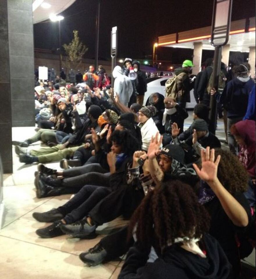 A group of protesters staged a sit-in for several minutes at a QuikTrip near the intersection of Vendeventer and Chouteau around 1:30 a.m. Sunday. Oct. 12