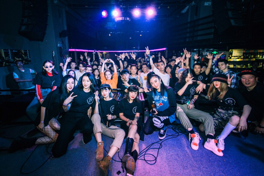 Members of the Bad Girls rap group, which was started by Deng Ge, pose with audience members at a pre-pandemic hip hop party. Now that the coronavirus is under control in Wuhan, audiences are once again gathering for concerts.