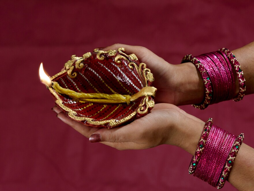 Millions of Indians light earthen lamps for the Diwali festival. Designs range from simple to fancy.
