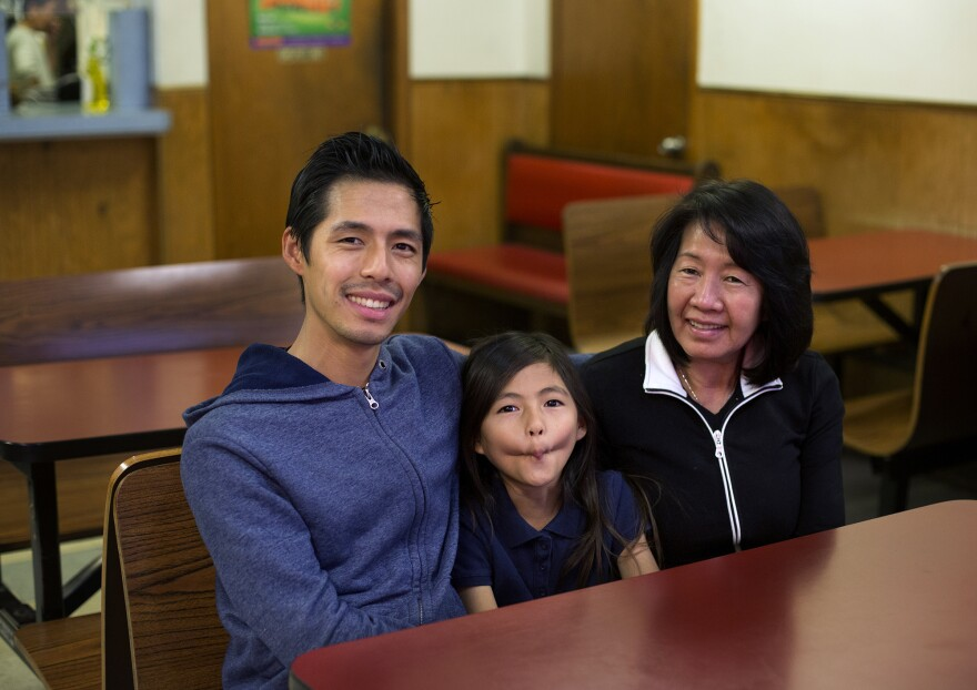 Cevin Lee poses with his daughter, Alana, and mother,  Phan Ly, at Hong Kong Express on South Grand Boulevard on Nov. 14, 2016.
