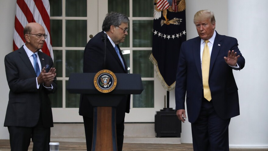 President Trump is joined by Commerce Secretary Wilbur Ross (left) and Attorney General William Barr during a July event at the White House announcing that his administration is relying on federal agency records to produce citizenship data.
