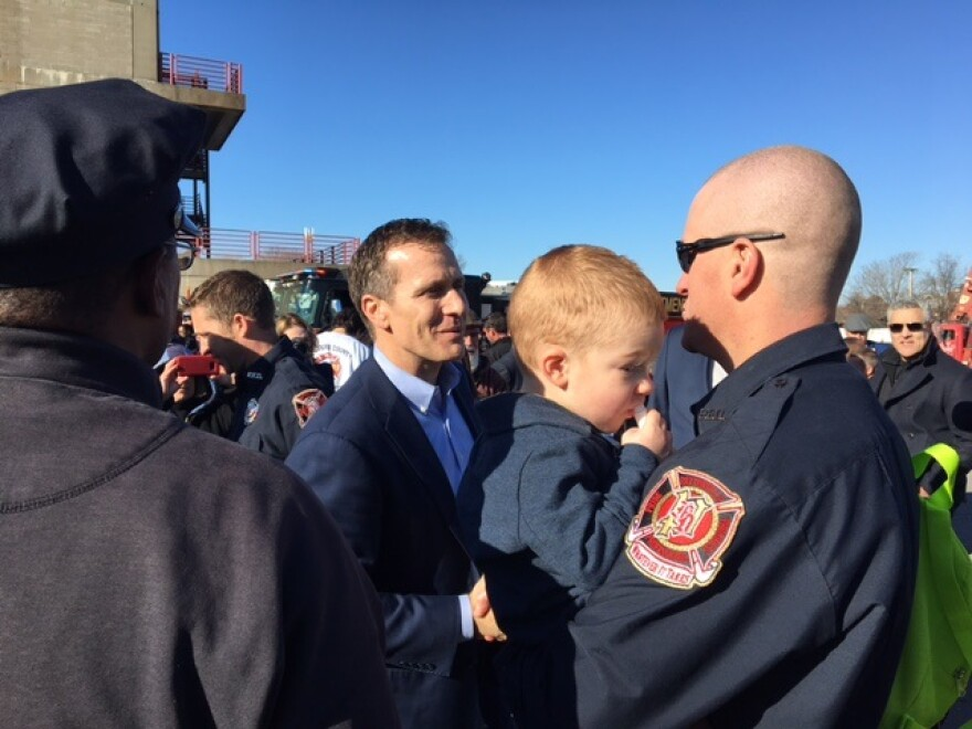 Missouri Gov. Eric Greitens greets St. Louis on Dec. 20, 2017, after shared his support for proposed legislation that would make it easier for Missouri firefighters and paramedics to qualify for workers compensation benefits if they get cancer.