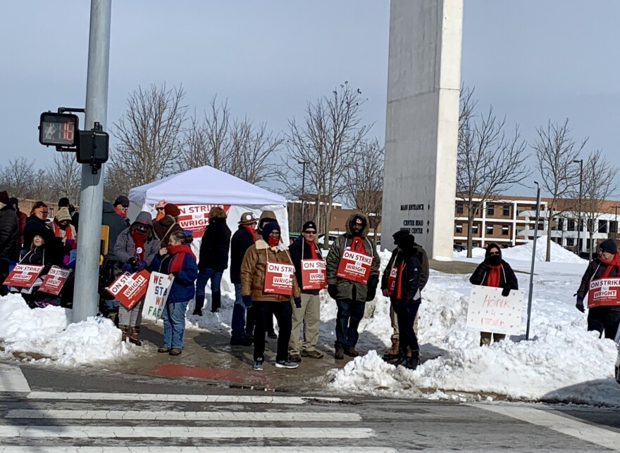 Faculty members picket at Wright State University's main entrance January 22.  Picket lines were canceled Wednesday and Thursday due to severe weather.